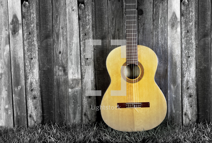 guitar against gray wood boards
