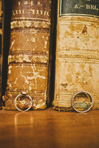 wedding rings leaning against old books