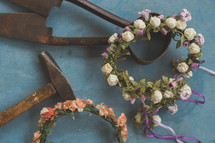blacksmith tools and crowns of flowers