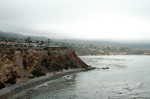 houses on cliffs along a shoreline