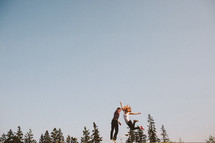 Couple jumping in midair