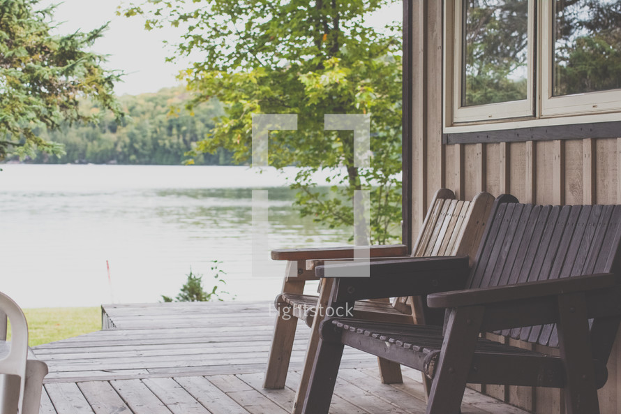 benches on a back deck near a lake
