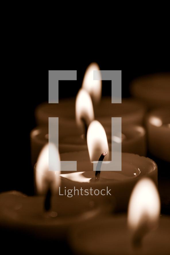 Lit votive candles.