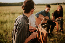 musicians practicing in a field