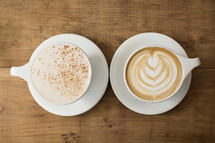 cappuccino mugs with different coffee art.