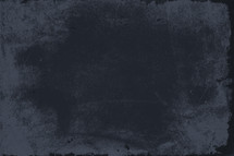 Dark navy blue grungy background.
