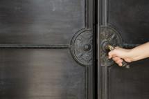 Woman opening a door