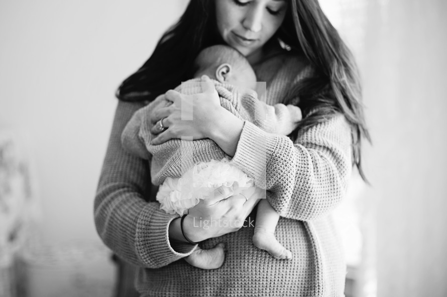 A mother holds her newborn baby.