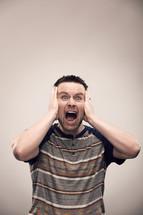 Angry man yelling.