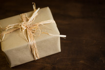 wrapped Christmas gift in brown paper