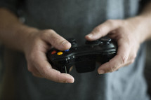 guy holding a video game controller.