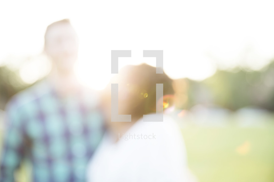 blurry image of a husband and wife