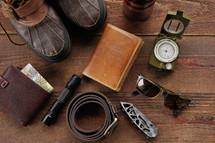 boots, wallet, belt, pocket knife, flashlight, sunglasses, passport, travel, compass, canteen, map, mission trip, exploration