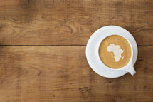shape of Africa in froth of a latte.