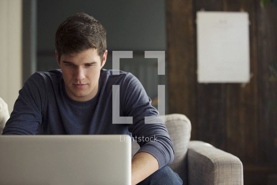 man looking at a computer screen.