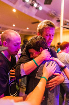 Man embracing young man, boy crying, prayer, love, healing