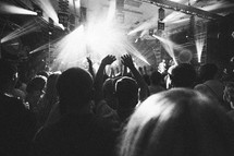raised hands by concert goers at a concert