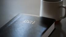 Holy Bible cover and coffee mug