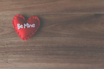 red felt heart with words be mine