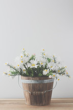 a wooden bucket for white daisies