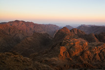 A sunrise shines on the mountains around Mount Sinai, Egypt.