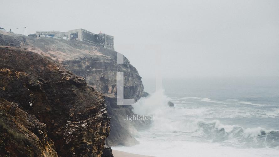 waves crashing into rock cliffs