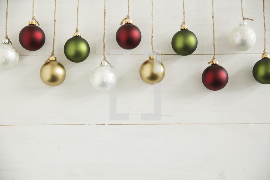 Christmas ornaments hanging from twine.