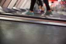 women walking on treadmills at the gym