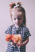 Girl holding roses.