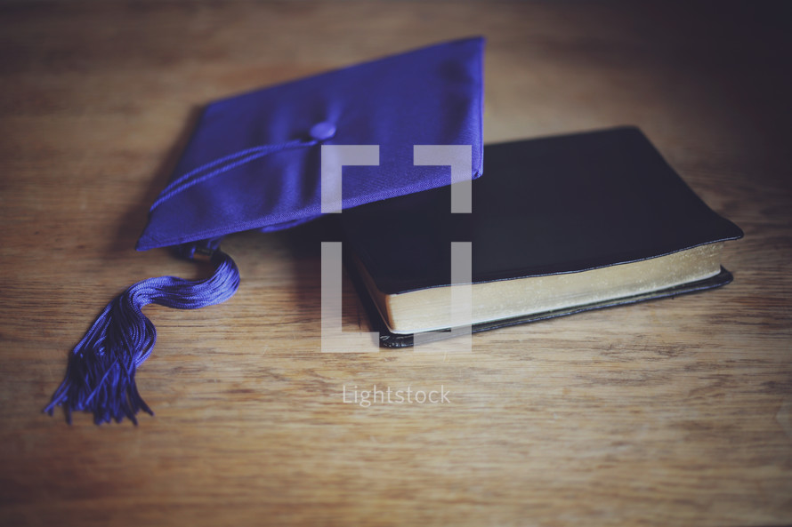 a mortar board and Bible together to celebration this young grad's new chapter