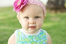 toddler girl in a head band