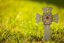 decorative cross in the grass