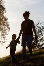 mother and son walking outdoors