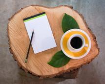 leaves, mug, coffee, saucer, log, cut wood, tree rings, stump, notepad, pencil