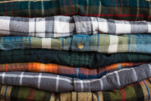 A stack of neatly folded flannel shirts.