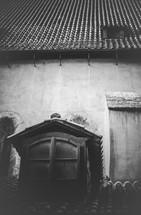 Dormer window on a Spanish tiled roof.