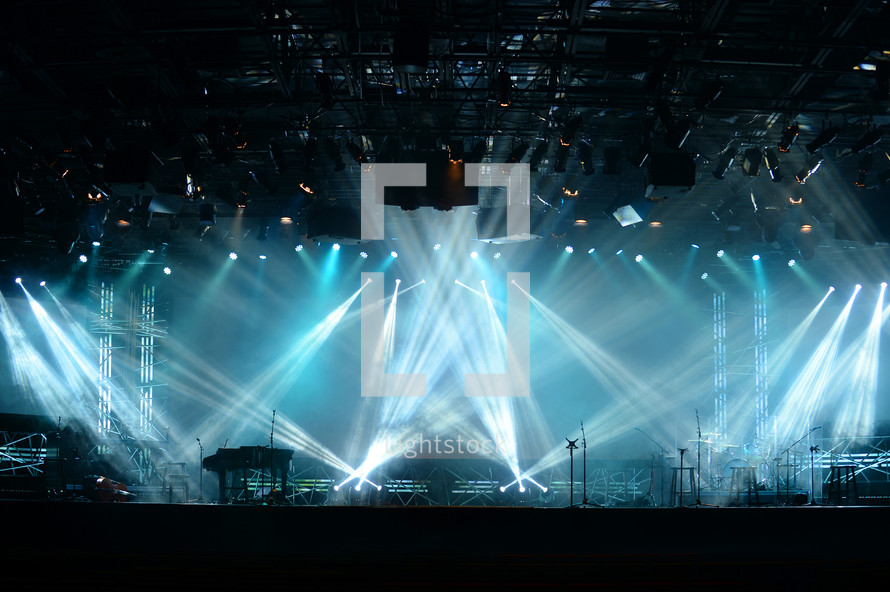 strobe lights on stage at a concert