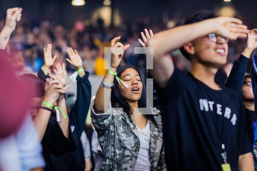 youth singing worship music at a conference