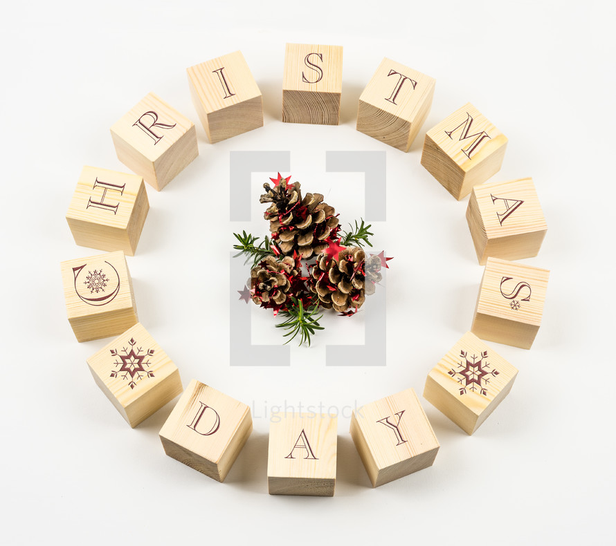 Christmas day on blocks and pine cones