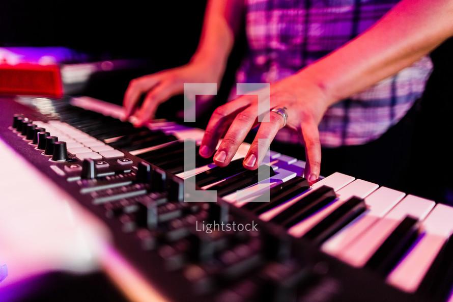 man playing a keyboard