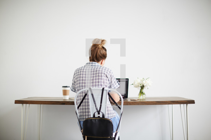 a woman sitting at a computer desk