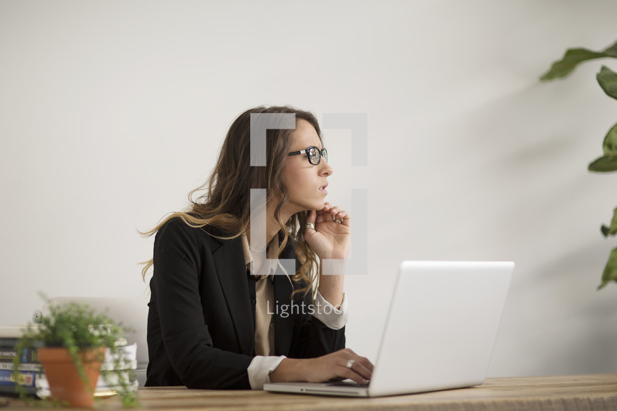 a woman working on a laptop computer