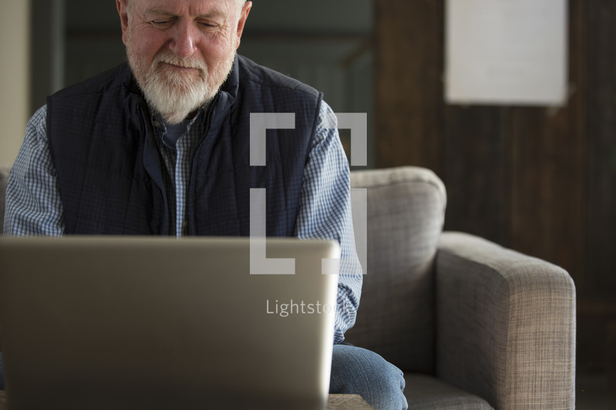 man looking at a computer screen