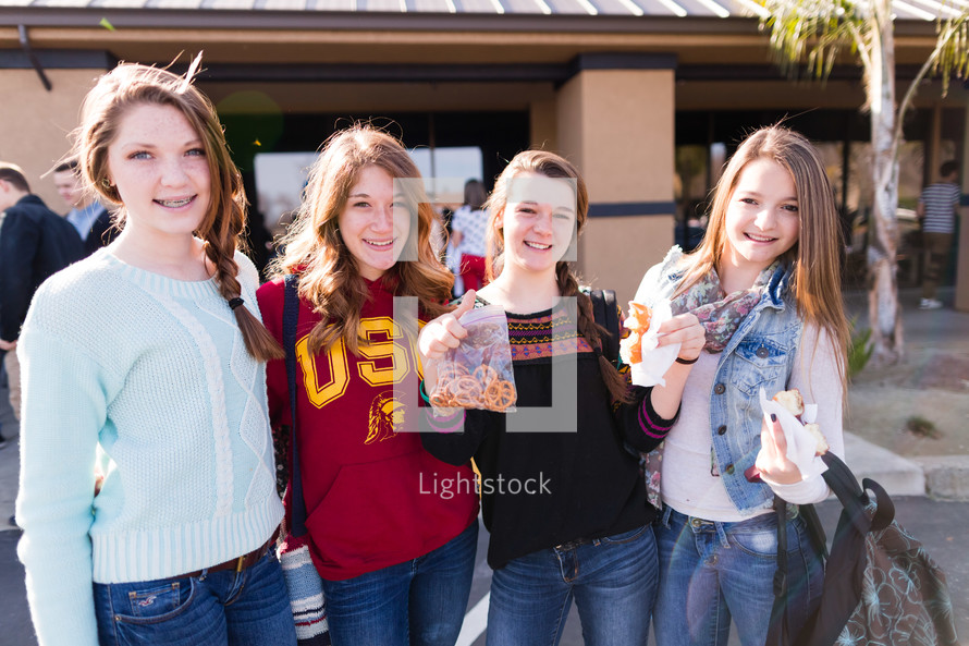 4 young girls Standing side by side