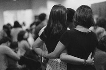 women hugging at church