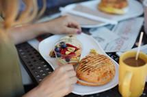 a woman eating breakfast