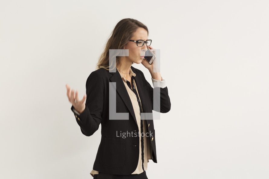 a frustrated woman shouting into a cellphone