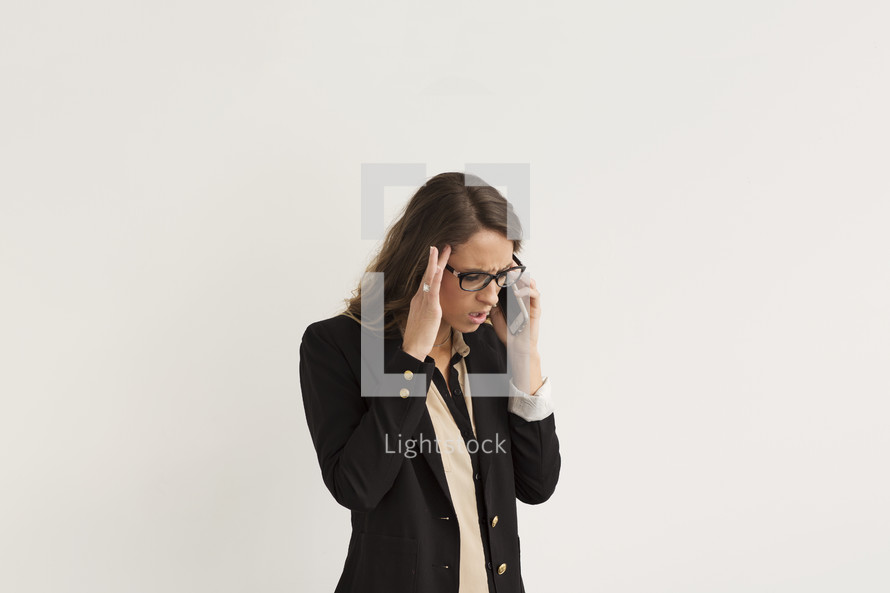 a frustrated woman talking on a cellphone