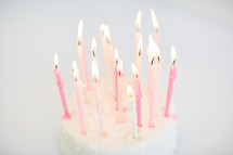 flames on birthday candles on a cake
