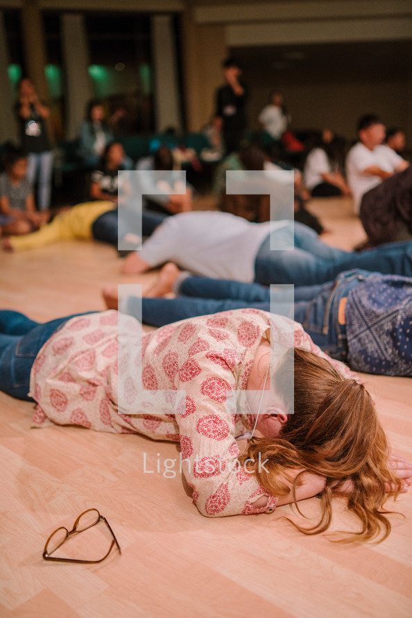 lying on the floor in tears during a worship service